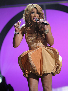 Tamar wearing a LOLITA ALONZO design during the 2011 Soul Train Awards